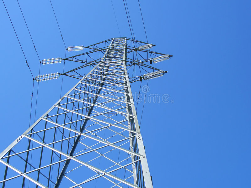 Powerline tower. Seen from below against blue sky stock images