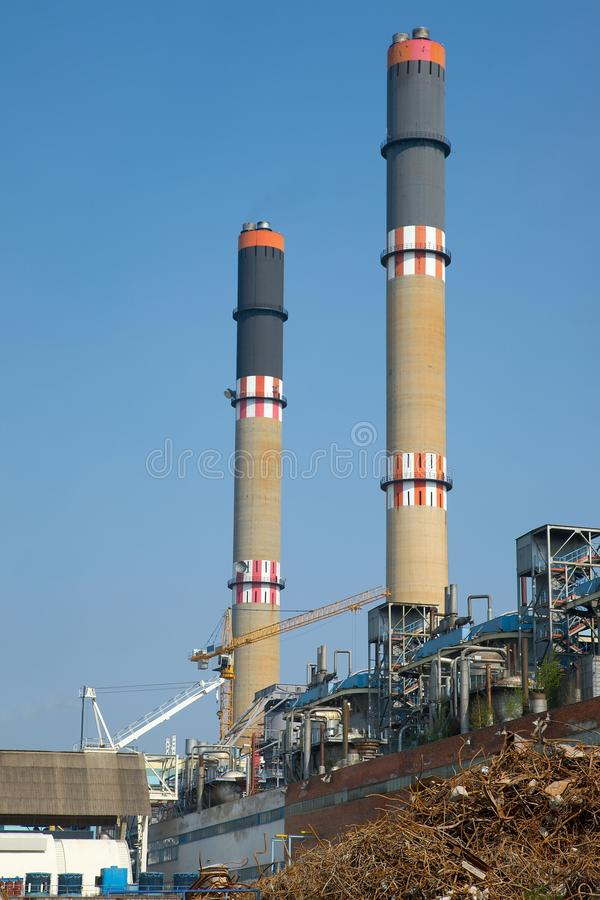 Powerplant. Industrial plant with huge chimneys royalty free stock photography