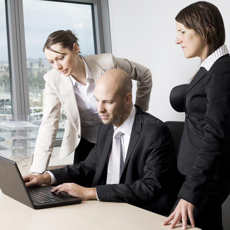 Powerpoint presentation. Group of office workers in a powerpoint presentation on laptop stock photo