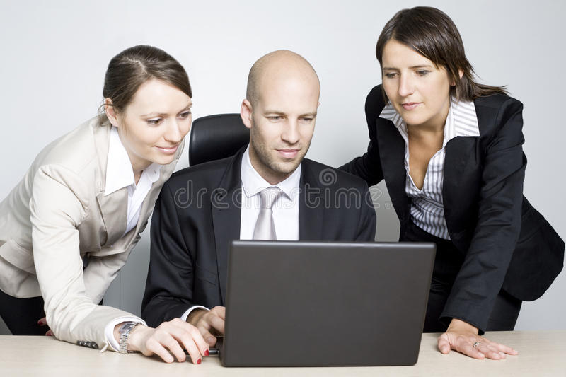 Powerpoint presentation. Group of office workers in a powerpoint presentation on laptop royalty free stock photo