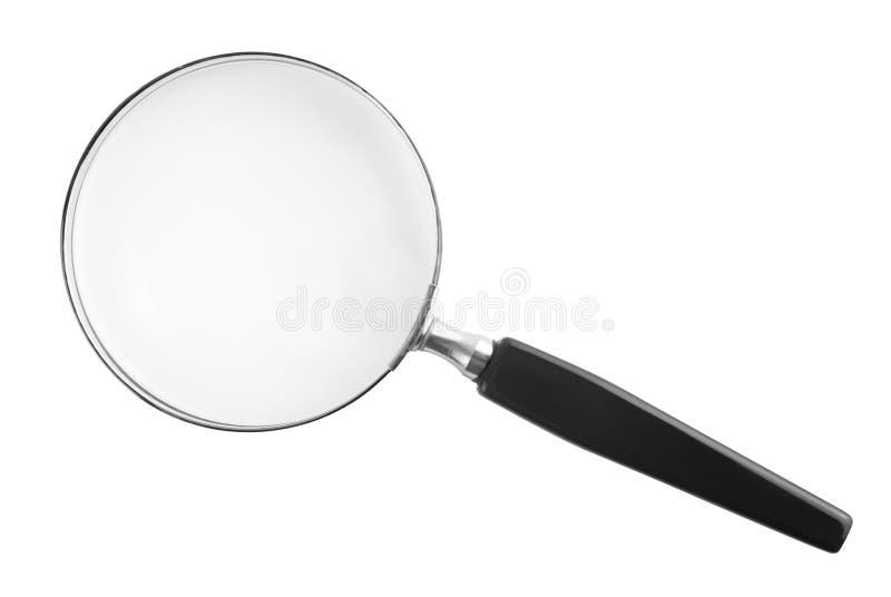 Powiększać - szkło odizolowywający obraz stock