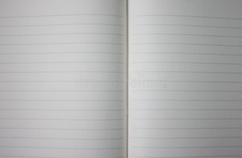 Powierzchnia biały notatnika tło fotografia stock