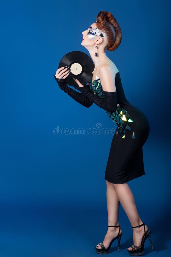 Pozaziemska kobieta z muzycznym albumem zdjęcia stock