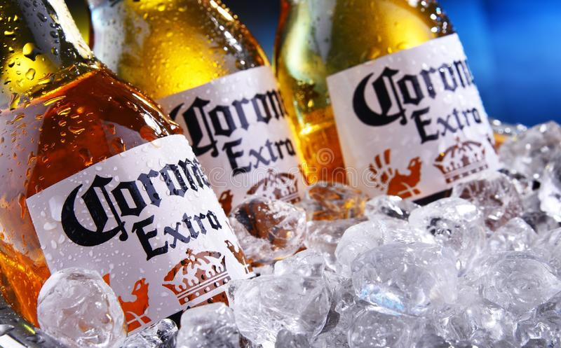 Bottles of Corona Extra beer in the bucket with crushed ice. POZNAN, POL - SEP 5, 2019: Bottles of Corona Extra, one of the top-selling beers worldwide, a pale stock photography