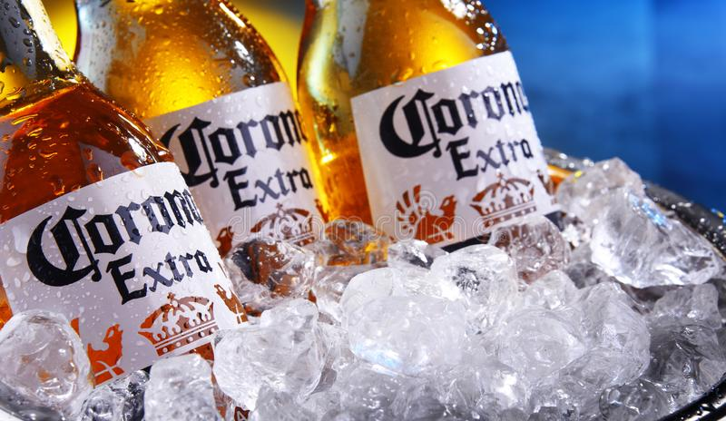 Bottles of Corona Extra beer in the bucket with crushed ice. POZNAN, POL - SEP 5, 2019: Bottles of Corona Extra, one of the top-selling beers worldwide, a pale stock photo