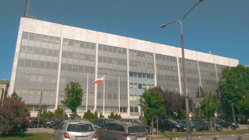 POZNAN, POLAND - MAY 20, 2018. Office building and waving Polish flag stock photos