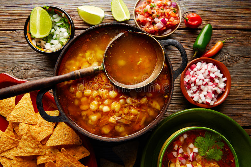 Pozole with mote big corn stew from Mexico. With ingredients and appetizer stock images