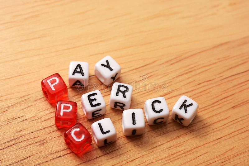 PPC text cubes. PPC text , pay per click cubes on wooden background royalty free stock photos