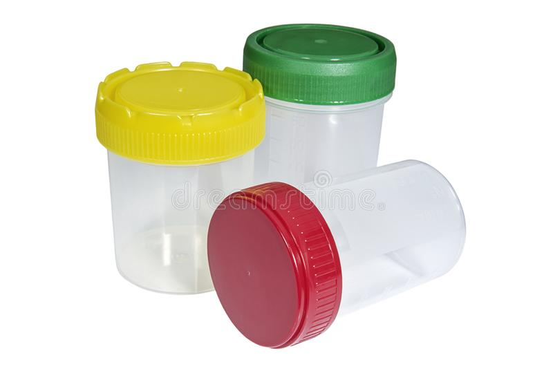 PPlastic medical containers with multicolored capslastic medical containers with multicolored caps. Plastic medical containers with multicolored caps isolated on royalty free stock photo