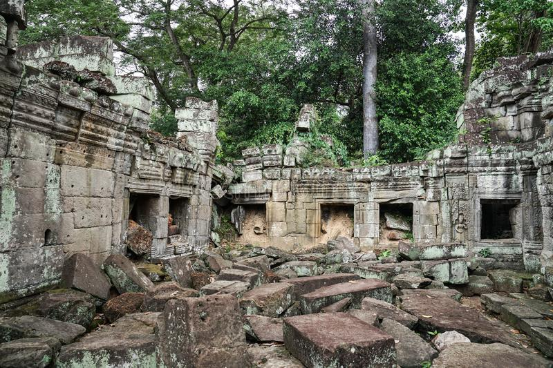PPreah Khan Temple. Preah Khan is a temple at Angkor, Cambodia, built in the 12th century. It is very old temple as we can see some tree grow upon the temple stock image
