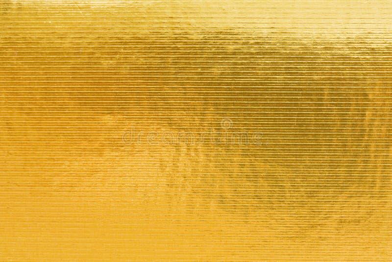 Präglad för guld av papp royaltyfri bild