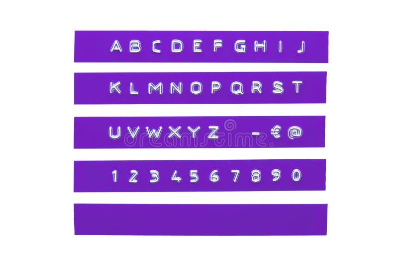 Präglat alfabet på det violetta plast- bandet arkivbild
