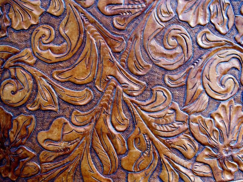 präglat inristat läder royaltyfria foton