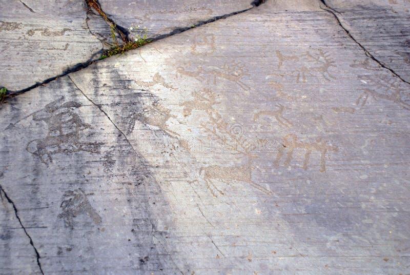Prähistorische Steincarvings, Valle Camonica Italien lizenzfreies stockfoto