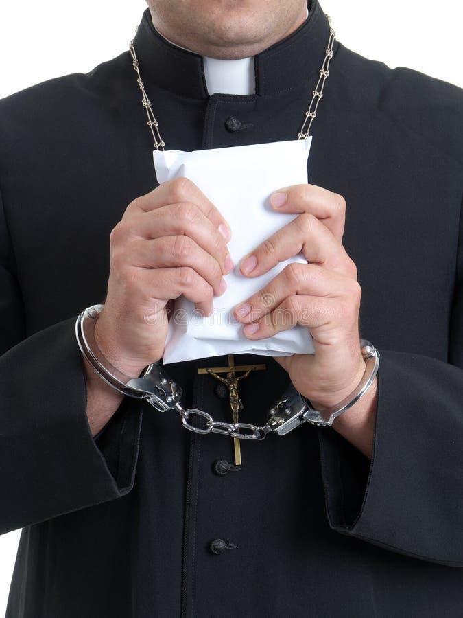 Präst med mutan arkivbild