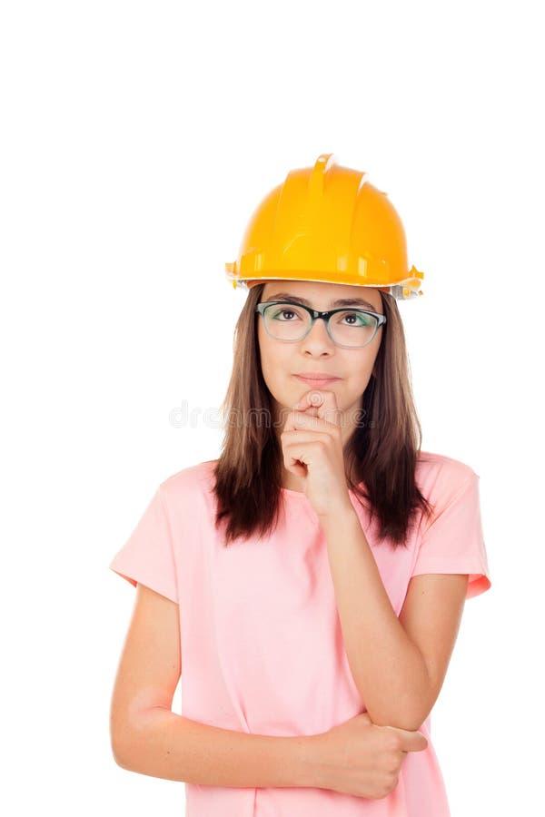 Préadolescent avec le casque de construction photographie stock