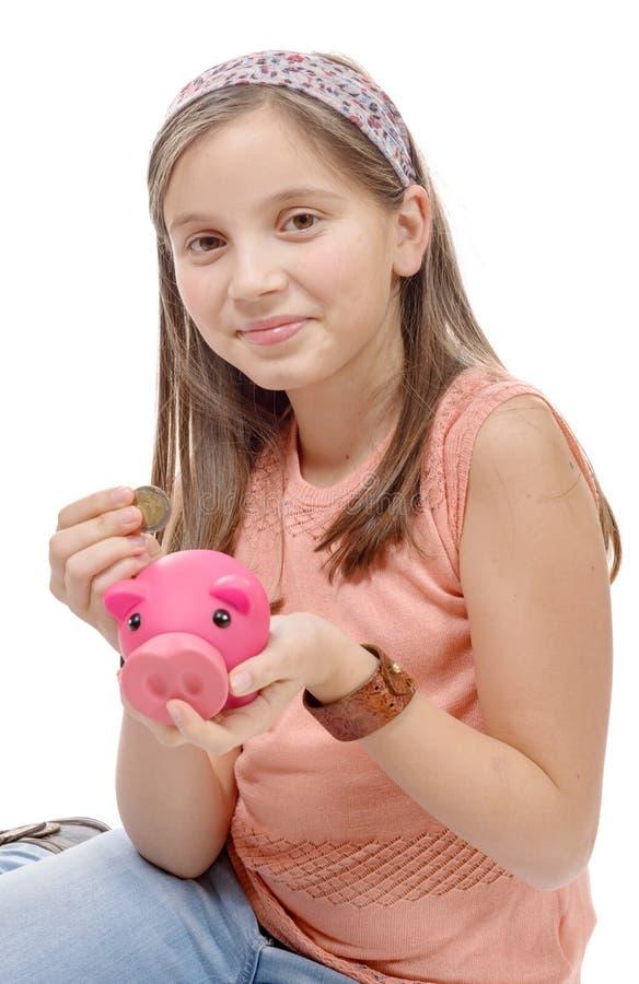Préadolescent avec une tirelire, sur le blanc photographie stock libre de droits