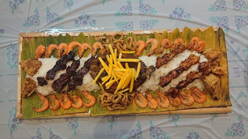 Préparation alimentaire traditionnelle philippine de combat de pognon basée sur la pratique militaire de la consommation photo libre de droits