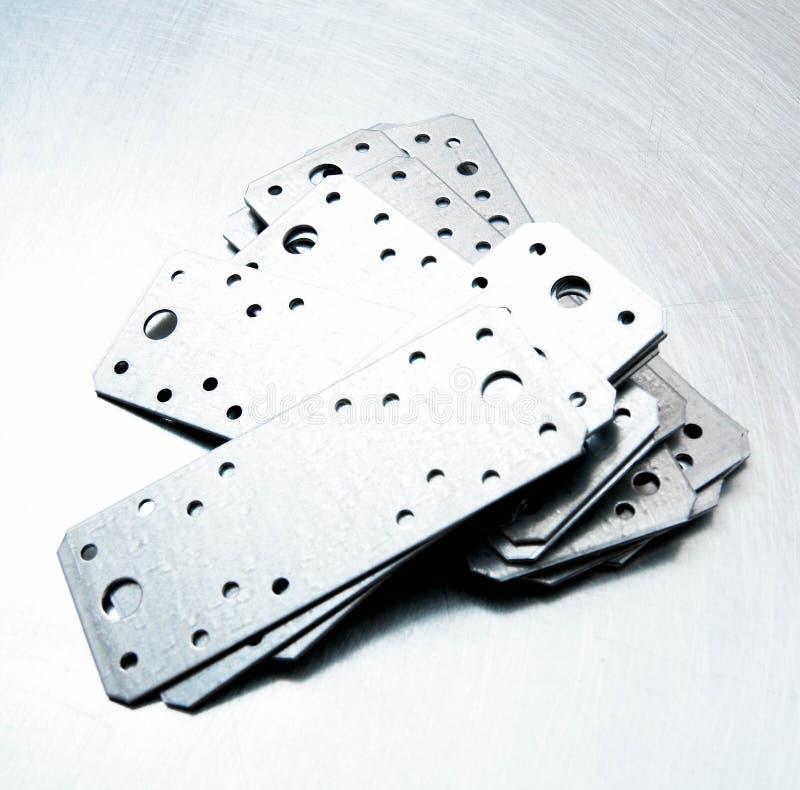 Préparations en métal et éléments de fixation sur photographie stock