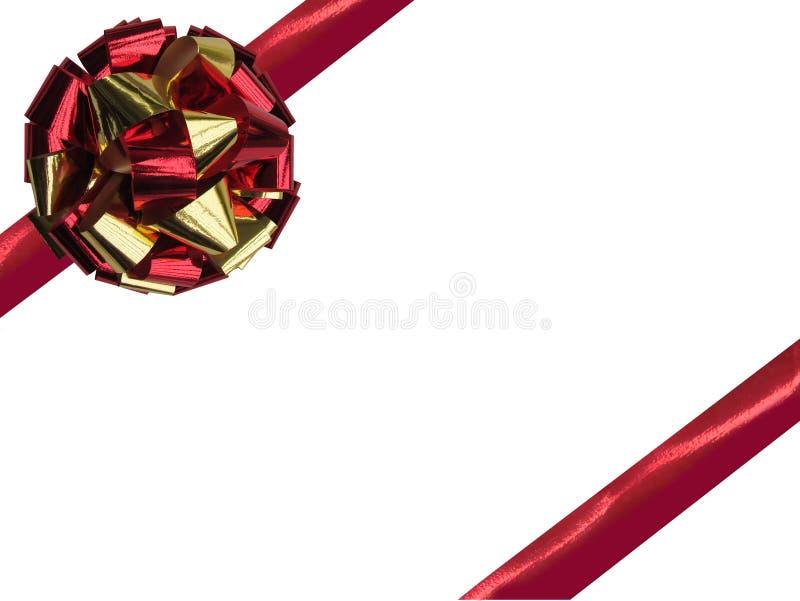 Présent avec l'arc d'isolement de rouge et d'or avec le ruban et l'espace vide photos libres de droits