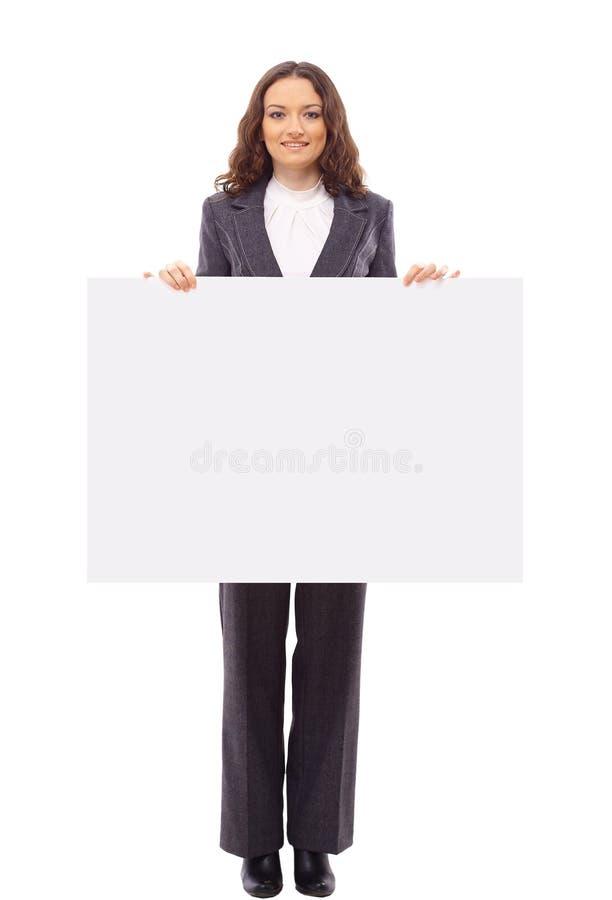 Présents de femme avec un panneau blanc blanc photos stock