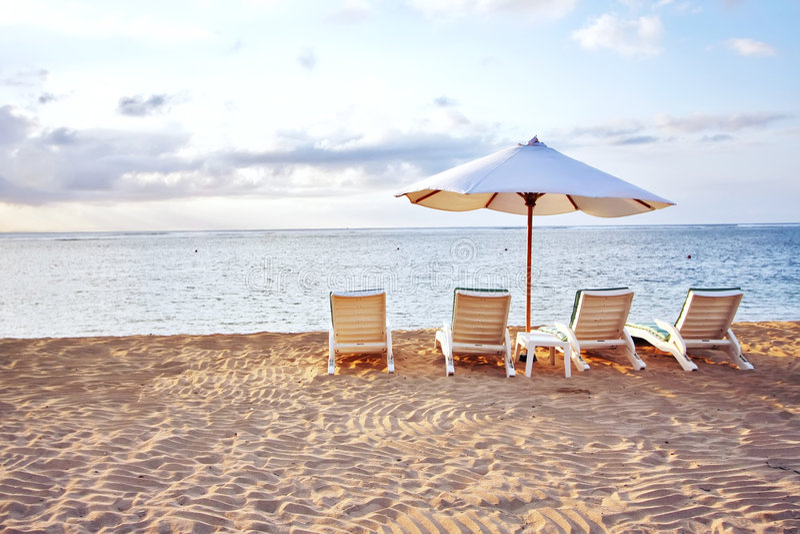 Présidence quatre à la plage image stock