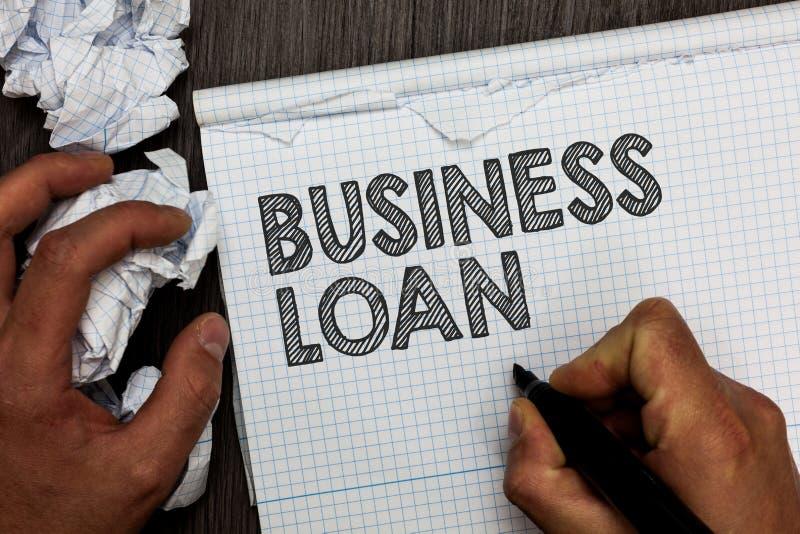 Préstamo empresarial del texto de la escritura de la palabra Concepto del negocio para el hombre de la deuda de los anticipos de  fotos de archivo
