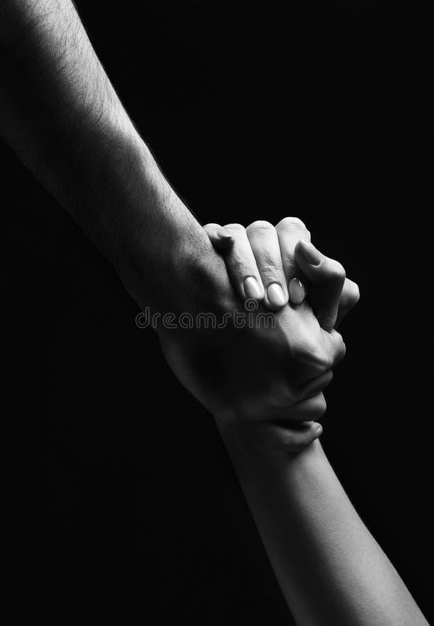 Prêtez une main en heure du besoin photo stock