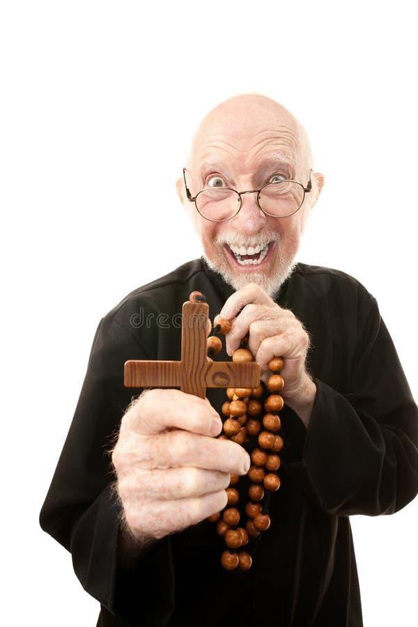 Prêtre écartant le mal images stock