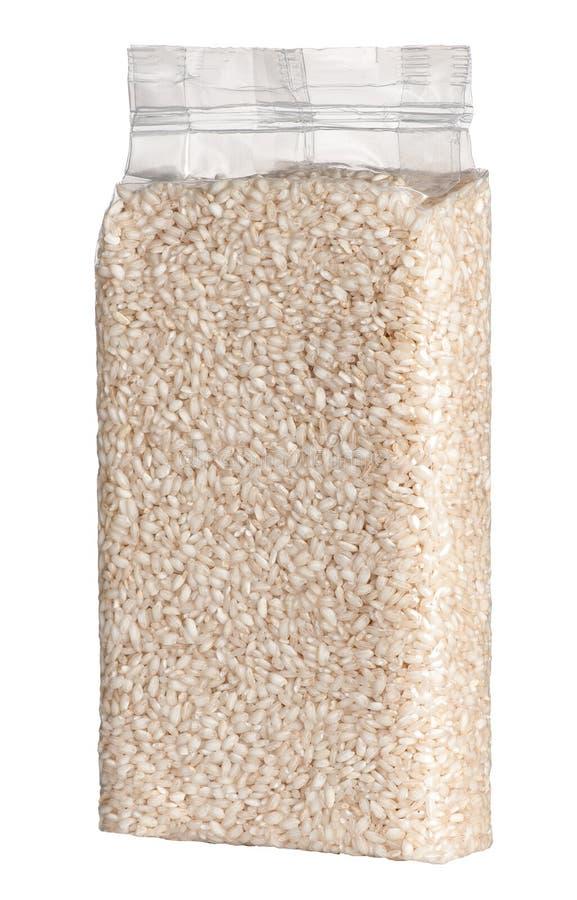 Próżnia - upakowana plastikowa paczka dłudzy zbożowi ryż obrazy stock