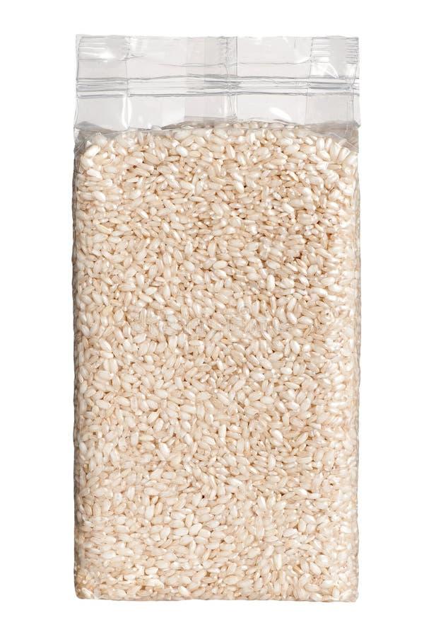Próżnia - upakowana plastikowa paczka długich zbożowych ryż frontowy widok obrazy stock