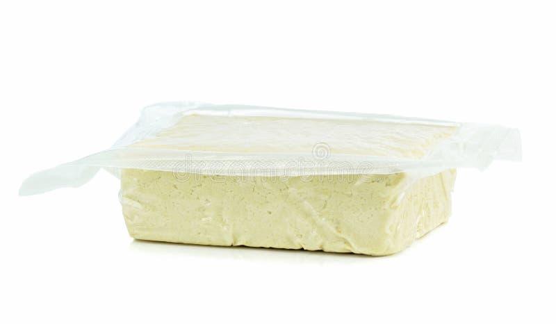Próżnia - upakowany blok tofu obraz stock