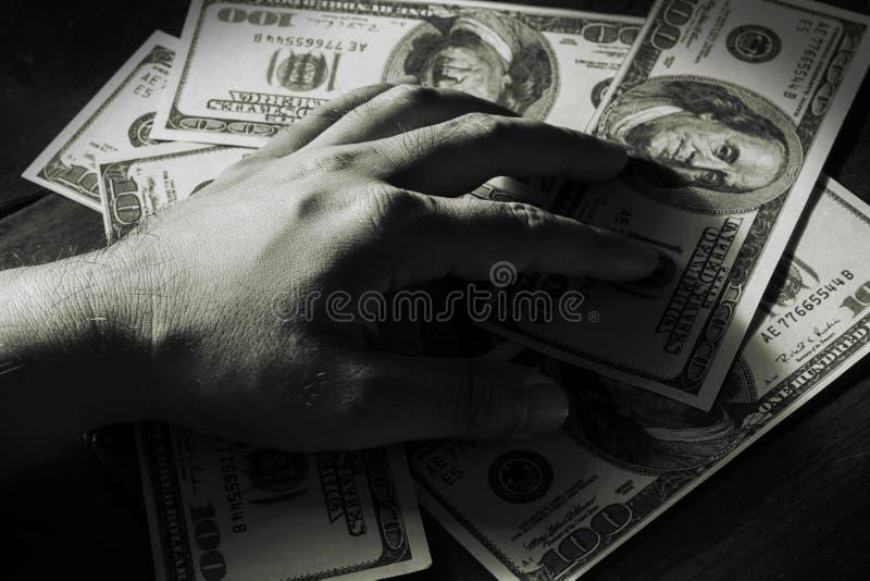 Próbuje utrzymywać pieniądze. fotografia stock