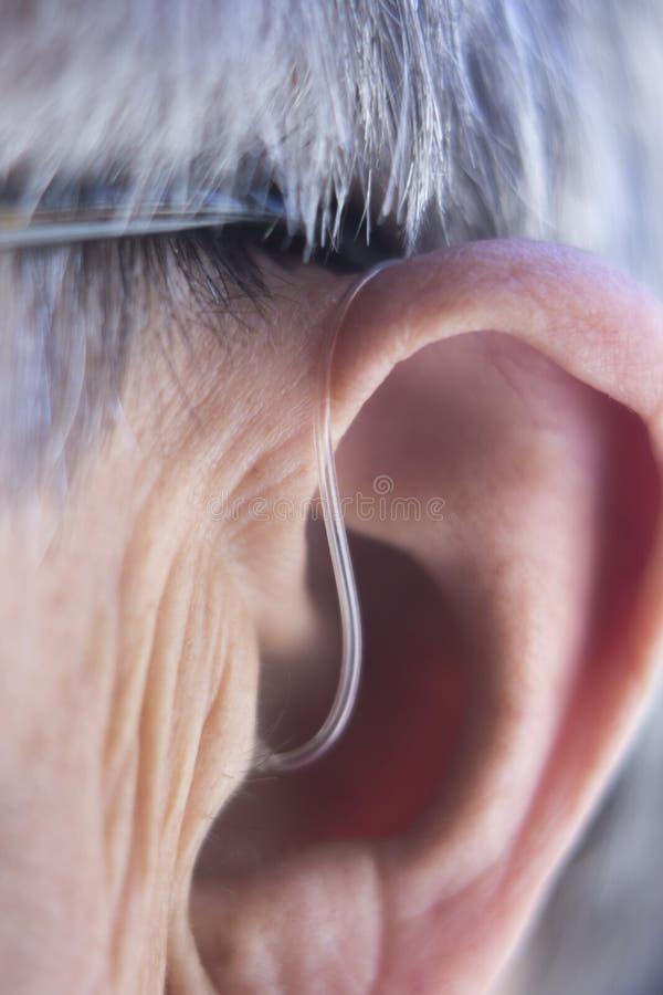 Prótese auditiva na orelha imagem de stock royalty free