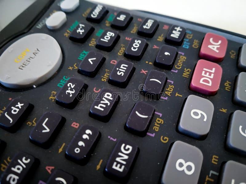 próximo acima da calculadora científica com fundo branco fotografia de stock royalty free