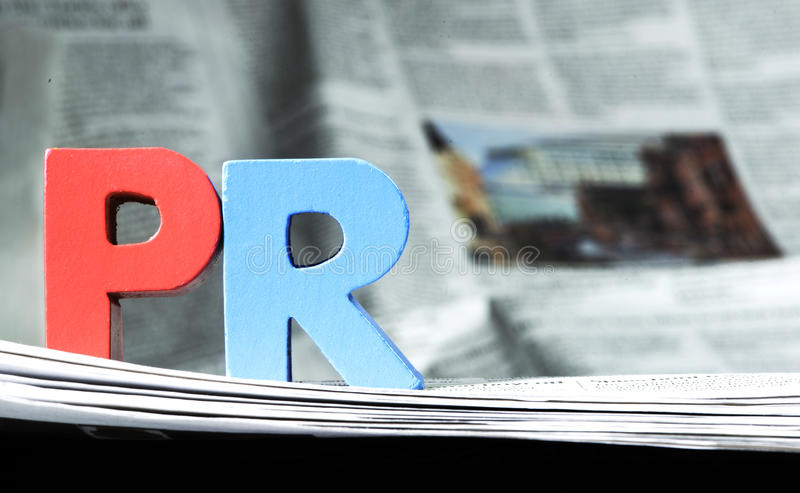 PR слова на газете стоковое фото rf