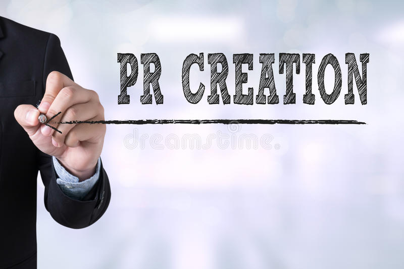PR CREATION. Businessman drawing Landing Page on blurred abstract background royalty free stock image