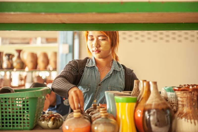 Soft focus, portrait of myanmar young girl with thanaka working in ceramic pottery shop. Singkhon border checkpoint. Thailand- royalty free stock photos