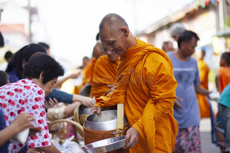 Prachuap khiri khan thailand - june2,2019 : thai woman offering food to thai monk on early morning , buddhism is main religion in stock images