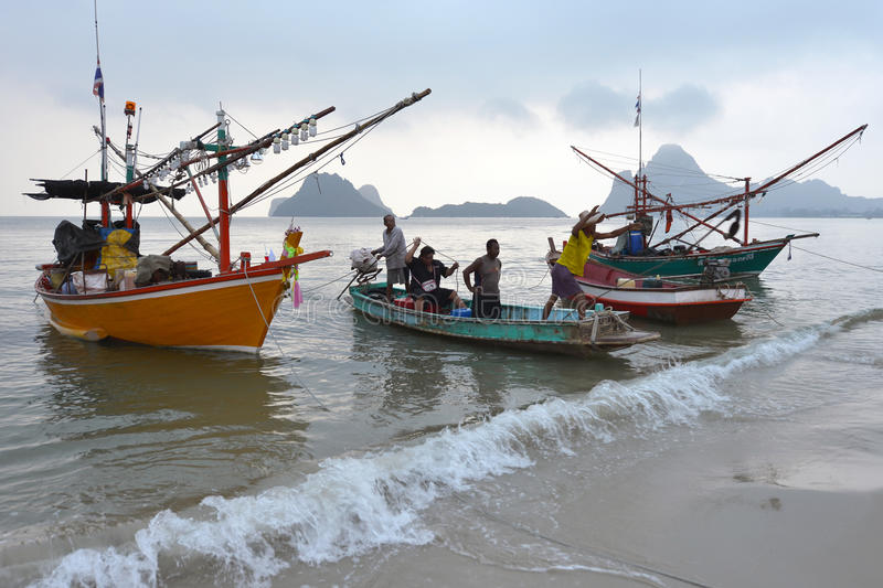 Prachuap Khiri Khan, Thailand. March 22: Fishermen unloading squid on the beach on March 22, 2014 in stock images