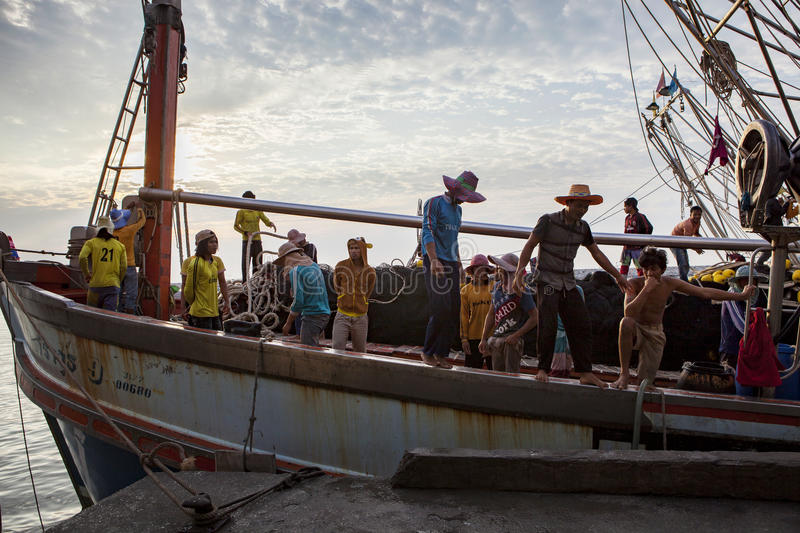 PRACHUAP KHIRI KHAN THAILAND - MARCH 29,2017 : worker on thai fishery boat approaching for located fresh fish to fishing port stock photos