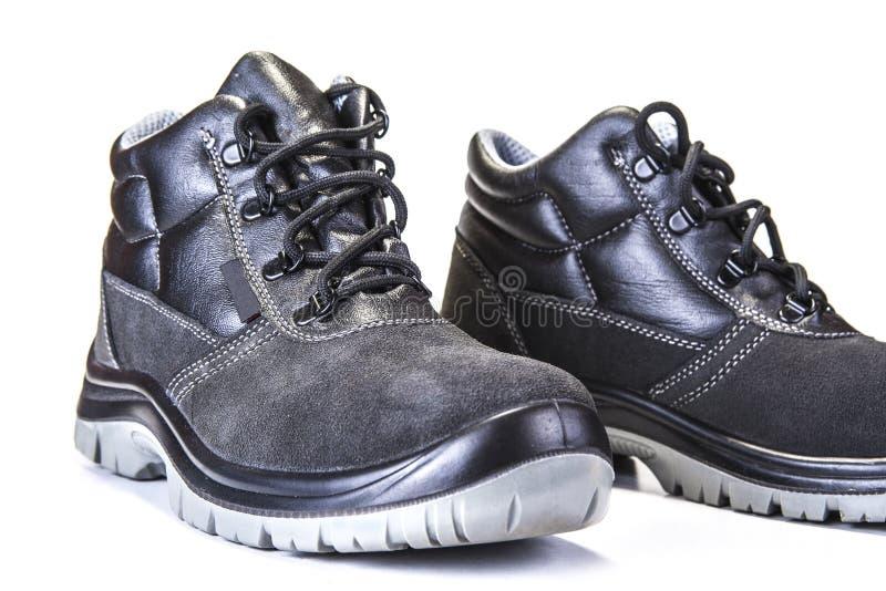 Pracować buty z stalowym talerzem ochraniać palec u nogi na bielu zdjęcie stock