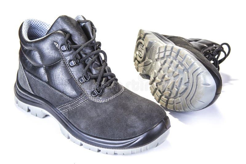 Pracować buty z stalowym talerzem ochraniać palec u nogi na bielu obraz royalty free