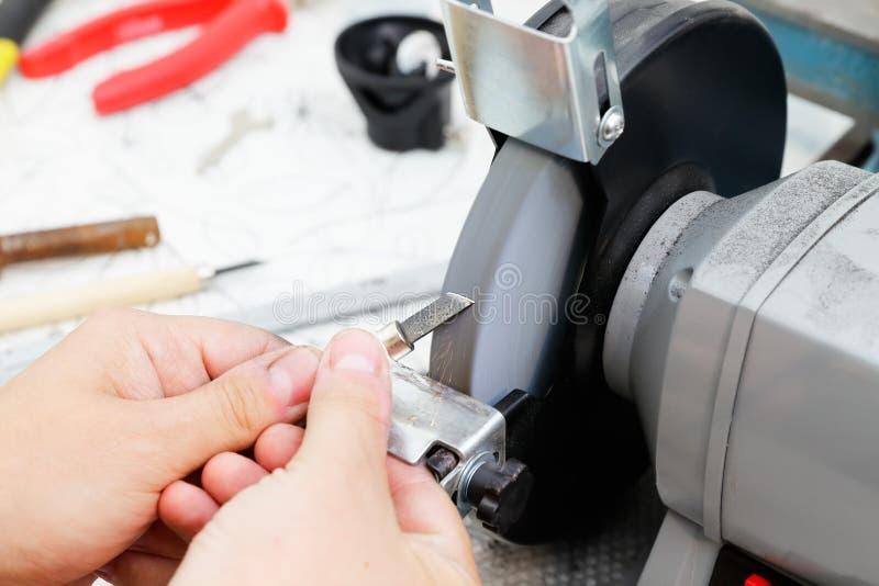 Pracować na szlifierskiej maszynie obrazy stock