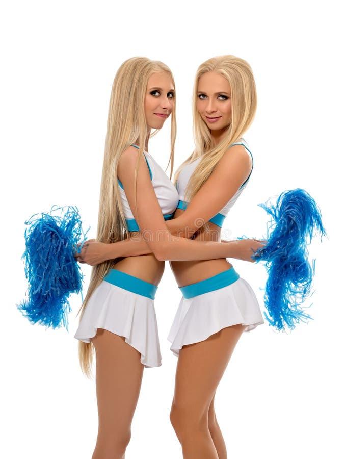 Pracowniana fotografia seksowny cheerleaders ściskać zdjęcia royalty free