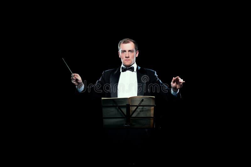 Pracowniana fotografia trzyma jego batutę muzyczny dyrygent zdjęcia stock