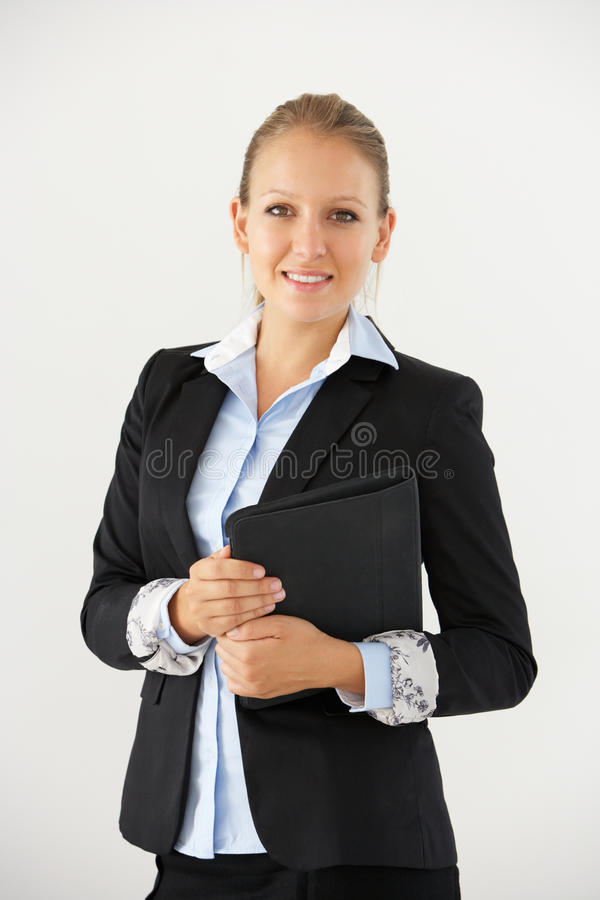 Pracowniany portret bizneswoman pozycja Przeciw Białemu tłu Trzyma Cyfrowej pastylkę obrazy royalty free