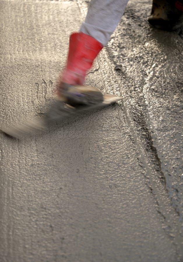 Pracownik apretury beton obraz stock