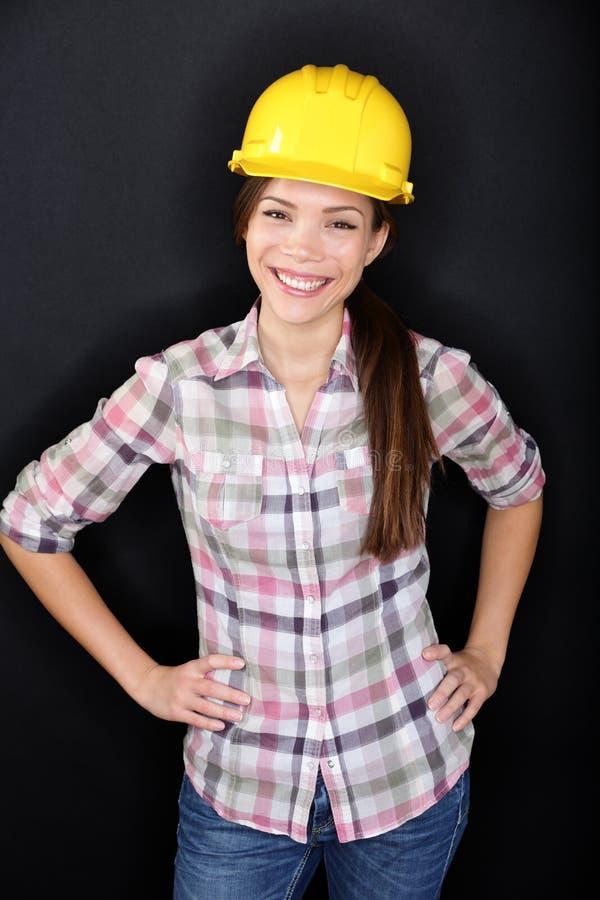 Pracownik budowlany kobiety szczęśliwy portret obrazy royalty free