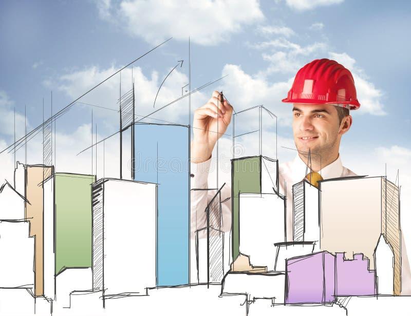 Pracownik budowlany planuje miasto widok zdjęcie stock